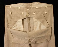 The trousers are fashioned from natural beige linen. The pockets and facings are écru cotton. The pockets, which are diagonally set in, are hidden by the fall front—see the detail pictures below. The trousers retain all of the original bone buttons.