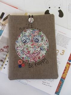 IPAD MINI SLEEVE WITH ADDED APPLIQUE DETAIL – SMILE BE HAPPY £12.50