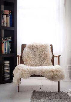 soft sheepskin throw on wood chair / sfgirlbybay