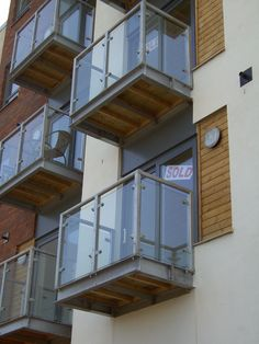 These mass produced balconies and are fabricated in mild steel then galvanized with toughened glass panels and metal hand rails. We fabricated a large batches of these balconies and installed them at apartments in Leeds, West Yorkshire.