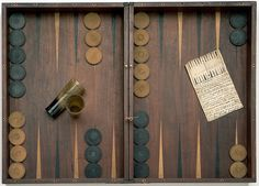 Backgammon board that belonged to Captain Matthew Flinders, before 1814. Horn, ivory, wood. Including the handwritten rules.
