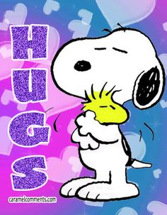 www.feelthehugs.com has a terrific video of dogs hugging.  Snoopy is a master hugger♥