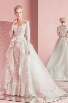 Long sleeve lace ballgown with sweetheart neckline and overskirt.   Zuhair Murad  Style: 16005WD99