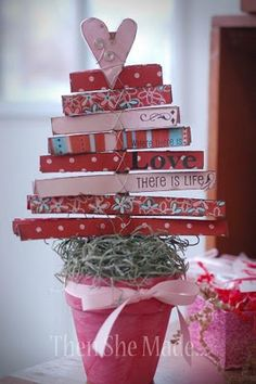 so am doing this...make a fabric covered pot and then this tree...so, so doing this !!!!