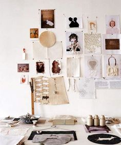 workspace. who needs built-ins and bulletins? Inspiration and mood boards pinned on a white wall.... simply refreshing.