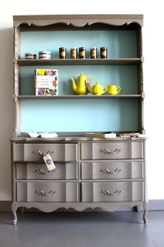 A French Provincial dresser and hutch finished in Coco Chalk Paint® decorative paint by Annie Sloan and a custom mix of  Provence, Pure White and Florence Chalk Paint®   By Kalology Studio
