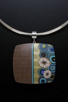 Meisha Barbee, polymer clay necklace made using a mica shift technique as a background to canes.
