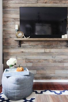 How to Create a Wood Pallet Accent Wall How to build a pallet accent wall in an afternoon. Includes tips on safe pallets to use, and building wire pathways for mounting a TV. Pallet Accent Wall, Pallet Walls, Pallet Furniture, Pallet Tv, Accent Walls, Pallet Lounge, Pallet Fireplace, Outdoor Furniture, Unique Home Decor