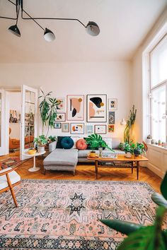 Minimalist art prints by Jan Skacelik dominates this mid-century boho interior, with a nice old furniture, rugs and hous. - Minimalist art prints by Jan Skacelik dominates this mid-century boho interior, with a nice old furniture, rugs and houseplants -