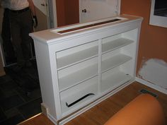Half wall entry way shoe storage - I would turn it around so it faced the door, not the dining room.