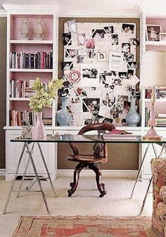 Home office design with bulletin board in wall shelving and clear glass desk top
