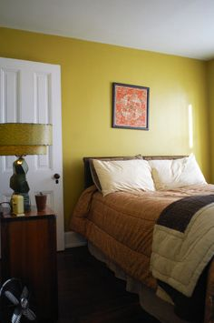 the mustard walls are by Sherwin-Williams, the color is called Sole, the number is 6898, currently called social butterfly - for guest room?