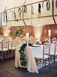 Mix of tall centerpieces and floral table runners.