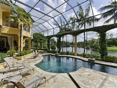 Tropical Swimming Pool with Raised beds, Pool screen enclosure, exterior stone floors, Master Pools Guild Paradise Pool 01
