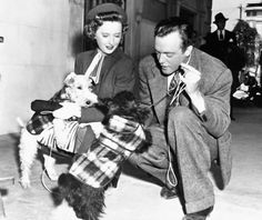 Barbara Stanwyck with Van Heflin and pups on the set of BF's Daughter 1948.