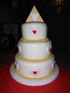 Legend of Zelda wedding cake - 3 tier red velvet w/cream cheese frosting, covered in mm fondant. Fondant accents. Gumpaste Triforce topper.