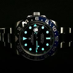 """or ?? Dark Knight rises. Cool lume shot of Rolex GMT-Master II BLNR or some call it """"Batman"""" (because of it's black and blue bezel) from @horologymania by rolexaholics"""
