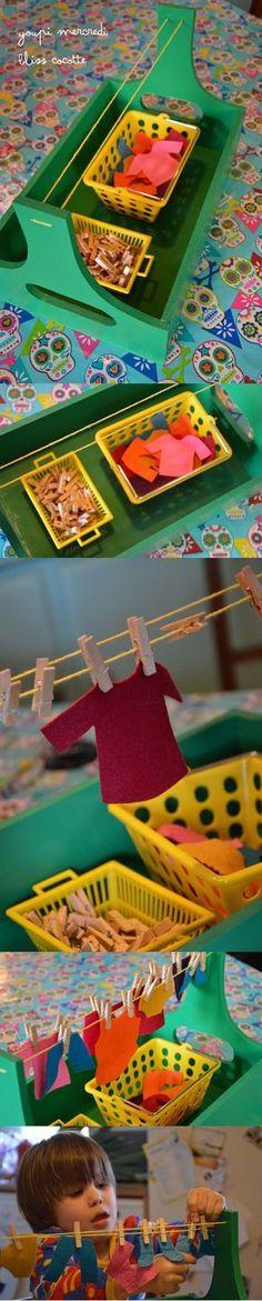 Adorable mini clothesline hanging for building preschool fine motor skills.