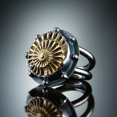 Cast Brass Ammonite Negative Ring. Fabricated Sterling Silver. www.amybuettner.com www.facebook.com/... www.etsy.com/...