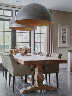 Rustic living with oversized lamps above table.