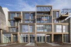 Imponujący projekt w Holandii, łączący przestrzeń do pracy z przestrzenią mieszkalną. Konstrukcja z drewna laminowanego. Woodlofts Buiksloterham,© Luuk Kramer