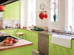 Transform every room in your house with just one tweak - we love these bright green cabinets!