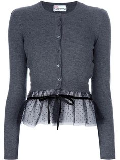 Grey wool cardigan from Red Valentino featuring a round neck, a central front button fastneing, long fitted sleeves, a sheer black polka-dotted hem section with a grosgrain bow detail.