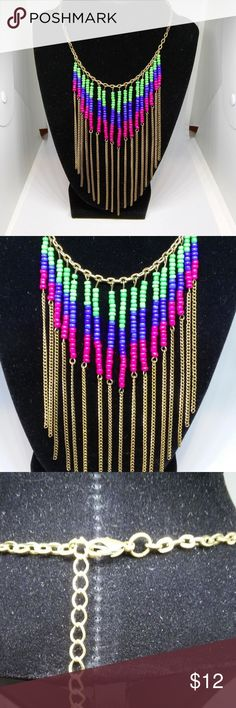 Necklace Statement Bright Seed Beads Southwest New with/out tag... Decree. Green, blue and red seed beads highlight this fashion statement necklace. Brass-tone rolo chain. 13.5-inch length with a 3-inch extender. Lobster claw clasp closure. This product not intended for use by or accessible to children 12 years of age or younger. Decree Jewelry Necklaces