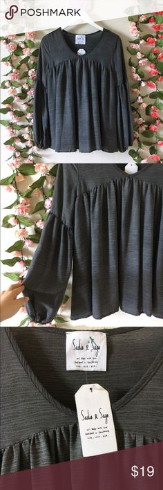 Sadie & Sage blouse Grey flowy long sleep blouse from the CA brand, Sadie & Sage. Lightweight and perfect for spring/summer. Size S fits true. NWT great condition no flaws. Sorry no trades or modeling but offers accepted!  **EVERYTHING I SELL IS IN FAIR TO GREAT CONDITION.I WILL ALWAYS SPECIFY ANY WEAR/TEAR.MY PRICES ARE SO LOW BECAUSE I AM A STAY AT HOME MOM & AM TRYING TO MAKE EXTRA INCOME TO SUPPORT MY LITTLE FAMILY!THANKS FOR CONTRIBUTING TO MY DREAM OF BEING A FULL TIME MOMMY! Sadie…