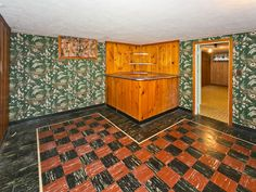 Love that floor and built in bar - just needs a pool table! 1940s basement