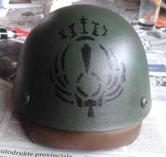 This is a Royal Italian Paratrooper stencil from World War Two. It was used by the Italian Airborne forces within Mussolini's Italian Paratrooper arm. Applied to one of our customers M42 helmets. www.warhats.com