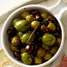 Warm Olives with Rosemary  Ingredients: Green olives, black olives, olive oil, sprig rosemary, fennel seeds, crushed red pepper. Calories: 110