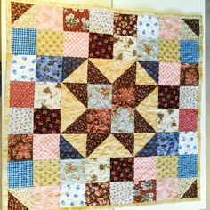 My Challenge!  Design and make a quilt in one day!  Big Star baby quilt. Free pattern! susies-scraps.com