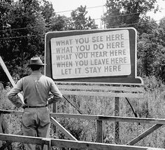 Ed Clark :: A billboard at the Oak Ridge Facility warning workers to keep silent about the work done on the Manhattan Project, the secret WWII program that built the atomic bomb, August 1945