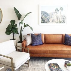 love the brown leather and white together in this living room!!
