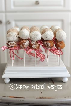 Probably not as good, but a lot easier to make than cake pops!  donut holes on sticks, cute and easy party food ideas