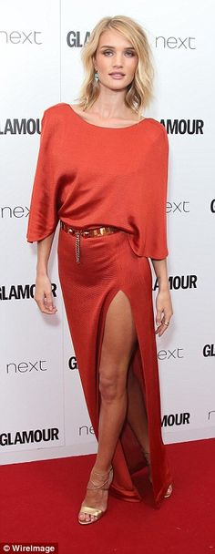 Showing some leg:Rosie Huntington-Whiteley covered up, up top but flashed some skin with ...