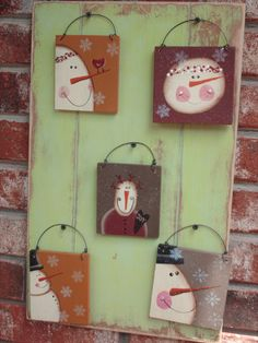 These primitive snowmen ornaments are cut from plywood. They are painted mustard, maroon and dark khaki. They have been sealed and hang by wire. They would be so cute on a primitive tree or attached to garland. The largest one measures roughly 4 x 4 Primitive Christmas, Christmas Signs, Christmas Snowman, Rustic Christmas, Winter Christmas, All Things Christmas, Christmas Decorations, Christmas Ornaments, Christmas Trees