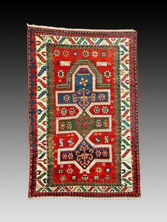 this is a beautiful Fachralo Kazak prayer rug.