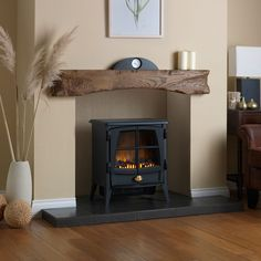This electric fire features a optiflame flame effect with & without heat which instantly adds an inviting warming glow to the room. This fire has a separate remote control for ease of use. Electric fire by Dimplex Lounge Design, Home Fireplace, Home, Cosy Living Room, Fireplace Design, Living Room With Fireplace, Living Room Designs, Log Burner Living Room, Freestanding Fireplace