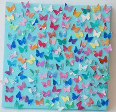 Schilderij van papieren vlindertjes, een vrolijk gezicht! Benodigdheden: - Blank canvas doek. - Acryl verf. - (Beetje) stevig wit papier. - Waterverf. - Een papier drukker. (de foto van dit voorwerp volgt later!) - Lijm.