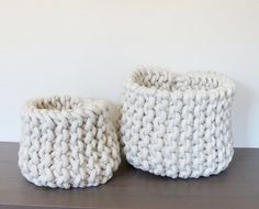 Nesting Rope Knit Baskets: Remodelistahand knit each basket with 1/2-inch cotton rope, which makes a sturdy shape with sides that stand up on their own.  The rope comes in a natural/white color, more of a cream tone. The large is approximately 11-12 inches tall and 13 inches in diameter. The small is about 9×9 inches.