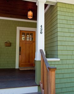 Possible exterior color scheme: pretty green shingles and natural wood door