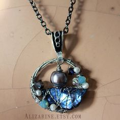 Treasures of the Deep---Guitar string pendant with beautiful, luminous freshwater pearls and sparkling Swarovski crystals--by alizarine