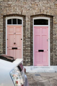 Peach & Pink doors. Looks so good with that colour of brick.