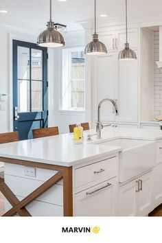 Natural light fills this modern farmhouse interior that perfectly blends both a modern style and farmhouse style without any extremes. Crisp white cabinets and bright windows complete this modern farmhouse kitchen look. Modern Farmhouse Interiors, Modern Farmhouse Kitchens, Farmhouse Design, Farmhouse Style, Marvin Doors, Door Design Interior, Casement Windows, Wood Accents, White Cabinets
