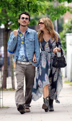 """""""I love Matthew's designs because they are so original – he doesn't conform. I love his use of colours and the kind of hippy philosophy behind his clothes."""" - Sienna Miller. Sienna and Matthew on a walk in London. She is wearing the peacock print dress from spring/summer 2004."""