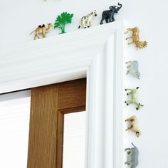 Toy animals marching around a door or window frame are a cute DIY addition to a kids room