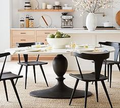 A striking mix of materials makes Chapman Marble Oval Dining Table a standout in a room. The veined white-marble top features a decorative lip along the rim and sits on a textured-bronze finished base. Dining Table Marble, Metal Dining Chairs, Extendable Dining Table, Oval Table Dining, Oval Coffee Tables, Home Decor, White Round Dining Table, Dining, Marble Dining