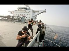 awesome SHOCKING FOOTAGE: SOMALI PIRATES TRY TO BOARD A CARGO SHIP WITH PRIVATE SECURITY GUARDS